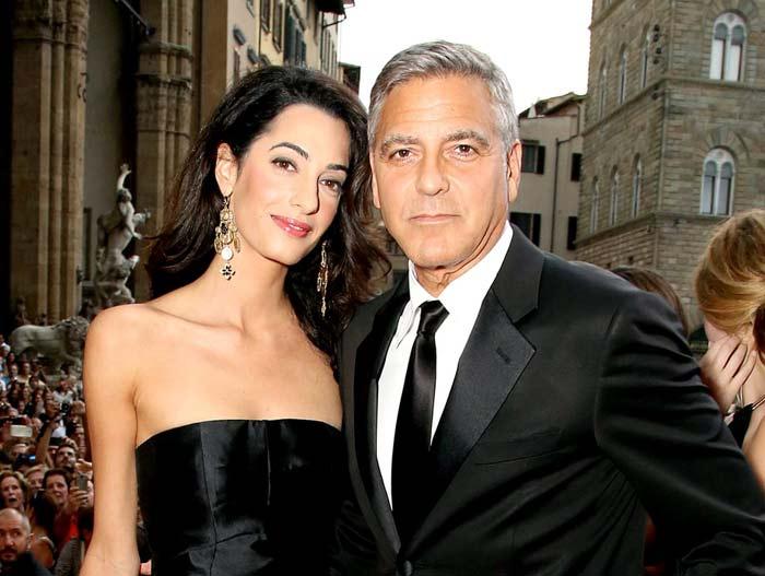 Джордж Клуни в смокинге и Амаль Клуни